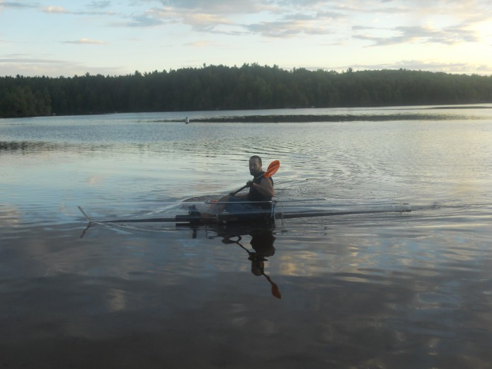 Mark Hebel paddling a clear kayak in St. Lawrence county ny