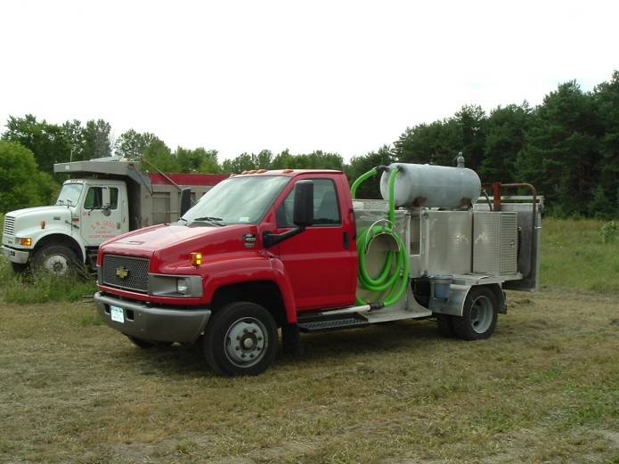 AJ's septic red chevy kodiak portable toilet service truck