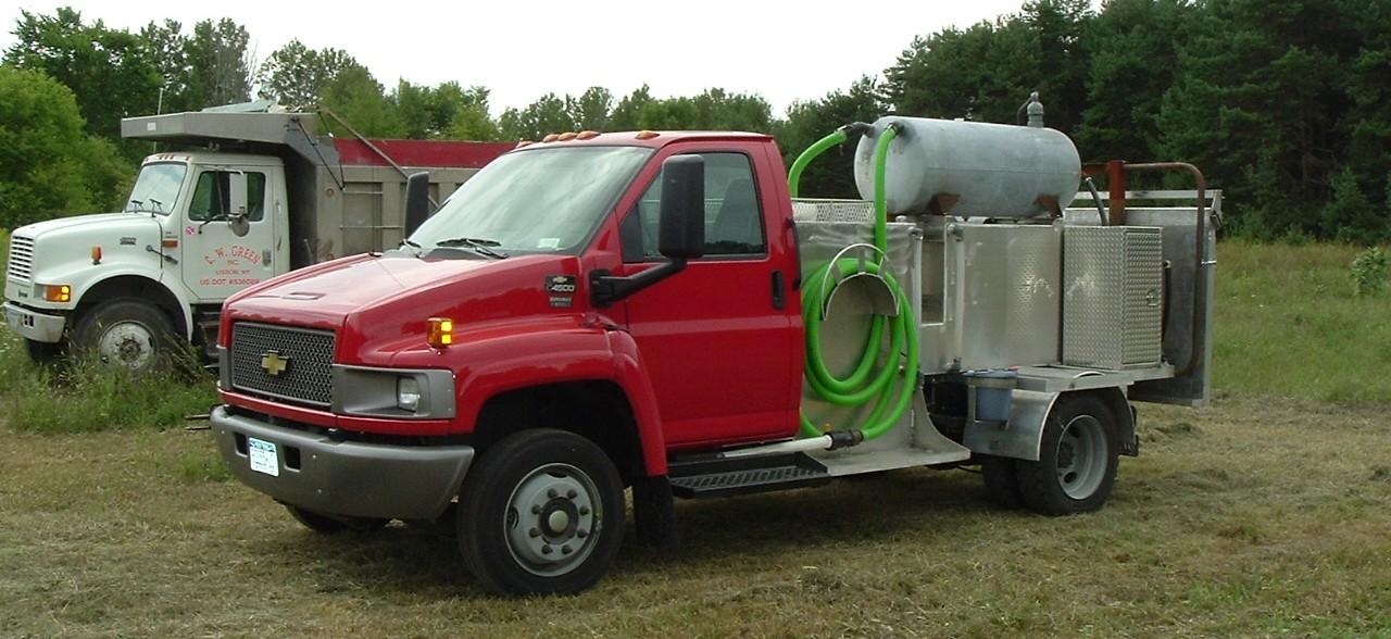 AJ's septic red chevy kodiak portable toilet service truck