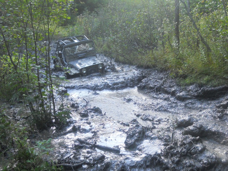 Bronco Jeep in deep mud to headlights at twisted trails