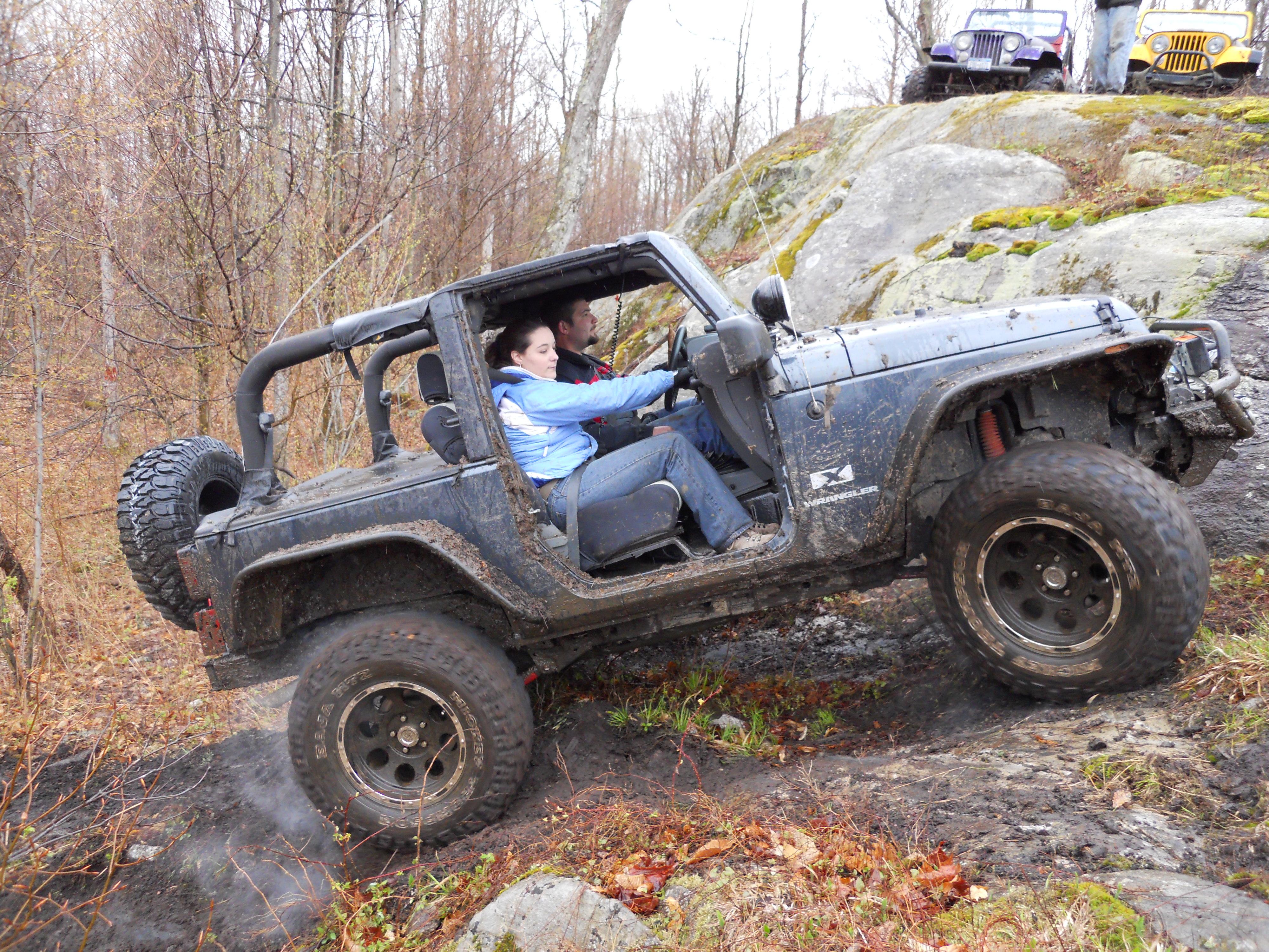Jeep JK tire smoke climbing rock